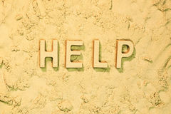 Help. Message in the sand Stock Photo