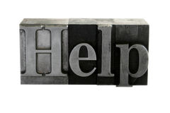 'help' in metal type Royalty Free Stock Photography