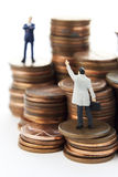 Help with money matters. Business figure with money royalty free stock image
