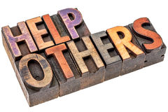 Help others in wood type Royalty Free Stock Image