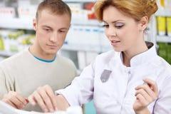 Help pharmacist Stock Photos