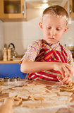 Help for preparing christmas cookies Royalty Free Stock Photos