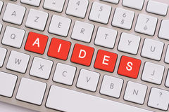 Help in red on white keyboard Stock Photography