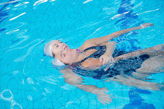 Help and rescue on swimming pool Royalty Free Stock Photography
