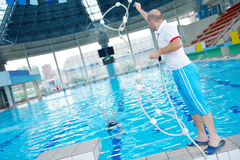 Help and rescue on swimming pool Stock Image
