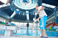 Help and rescue on swimming pool Royalty Free Stock Photo