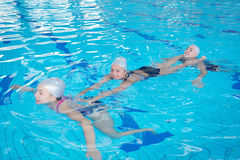 Help and rescue on swimming pool Royalty Free Stock Image