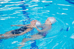Help and rescue on swimming pool Stock Photo