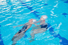 Help and rescue on swimming pool Stock Photography
