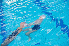 Help and rescue on swimming pool Stock Photos