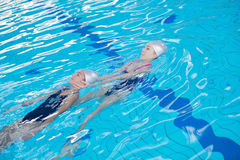 Help and rescue on swimming pool Royalty Free Stock Photos