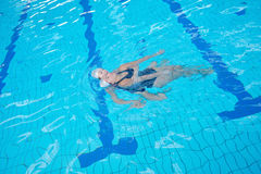 Help and rescue on swimming pool Royalty Free Stock Images