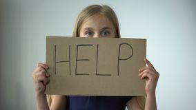 Help sign in little girls hands, assault in family, childrens rights protection. Stock footage stock video
