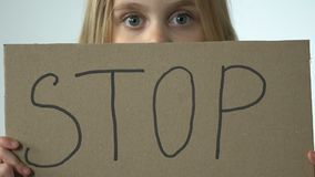 Help sign in scared little girl hands, child needs protection against violence stock video footage