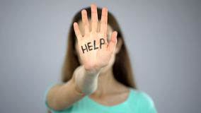 Help sign on womans hand, victim asking for help, assault in family, awareness. Stock photo stock images