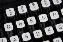 HELP sleutels op oud toetsenbord royalty-vrije stock foto's