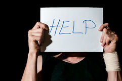 Help. Suicidal depression. Man holding help sign paper stock photos