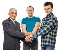 Help and support between generations. Male generations - grandfather, son and grandson holding hands, giving help and support each other Royalty Free Stock Photos