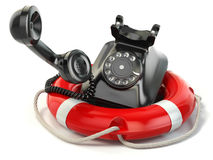 Help or support service concept. Telephone and life preserver is Stock Photography