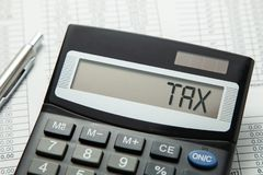 Help in taxes. Inscription TAX on the display on the calculator Stock Image