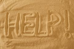 Help text Sign on the beach. Help Sign text on the beach. Sos symbol concept Stock Images