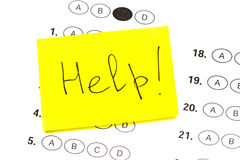 Help  is a text written on standardized quiz or test score Stock Image