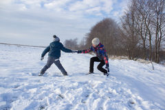 Help to climb out of snow Stock Photos