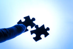 Help: to join puzzle (blue). To join puzzles like symbol of help or symbol of contact (interaction Royalty Free Stock Photography