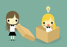 Help to think outside box woman version. Businesswoman outside thebox help businessman who is in the box and has bulblight on his head Stock Photography