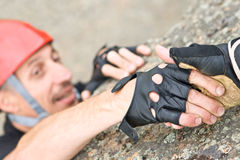 The help two rock-climbers each other in outdoor Stock Image