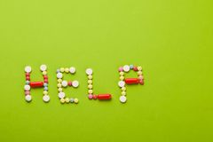 Help of vitamins. The word help made of colored vitamins Royalty Free Stock Photo