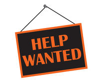 Help Wanted. A black and orange help wanted sign with copy space Royalty Free Stock Photo