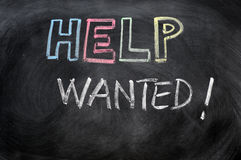 Help wanted. Message written in chalk on a blackboard Royalty Free Stock Photos