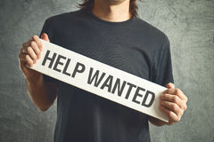 Help wanted. Casual man asking for help. Royalty Free Stock Photography