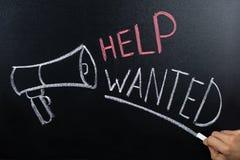 Help Wanted Concept Written On Blackboard stock photo