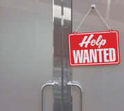 Help Wanted sign on business door Stock Image