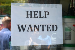 Help Wanted. A Help Wanted Sign on a New York City store stock photo