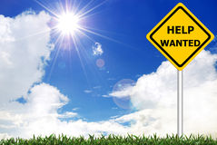 HELP WANTED on warning sign. HELP WANTED on yellow road warning sign stock photography