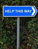 Help This Way Sign Stock Photos