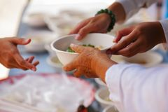 Free Help With Feeding Homeless People To Alleviate Hunger. Poverty Concept Stock Photo - 118467850