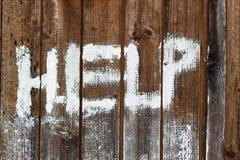 HELP on wood Stock Photo