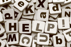 Help!. Word Help on a  letters heap. Sepia. Close-up Royalty Free Stock Images