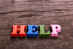 Help word made of wooden letters Royalty Free Stock Photo
