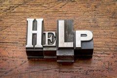 Help word in metal type Stock Photos