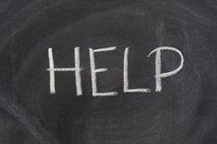 Help word on a school blackboard Royalty Free Stock Photos