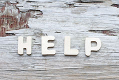 Help. Word Help on wooden vintage scratched background royalty free stock photography