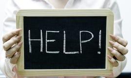 Help word written on blackboard/chalkboard Stock Images