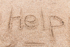 Help! write sand. Help! stranded on the beach write sand Stock Images