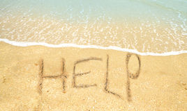 Help written in the sand Royalty Free Stock Photo