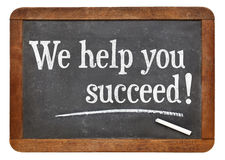 We help you succeed on vintage blackboard Stock Photo